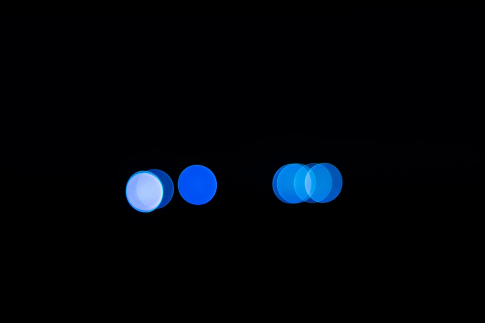 bokeh light photography of blue and white lights
