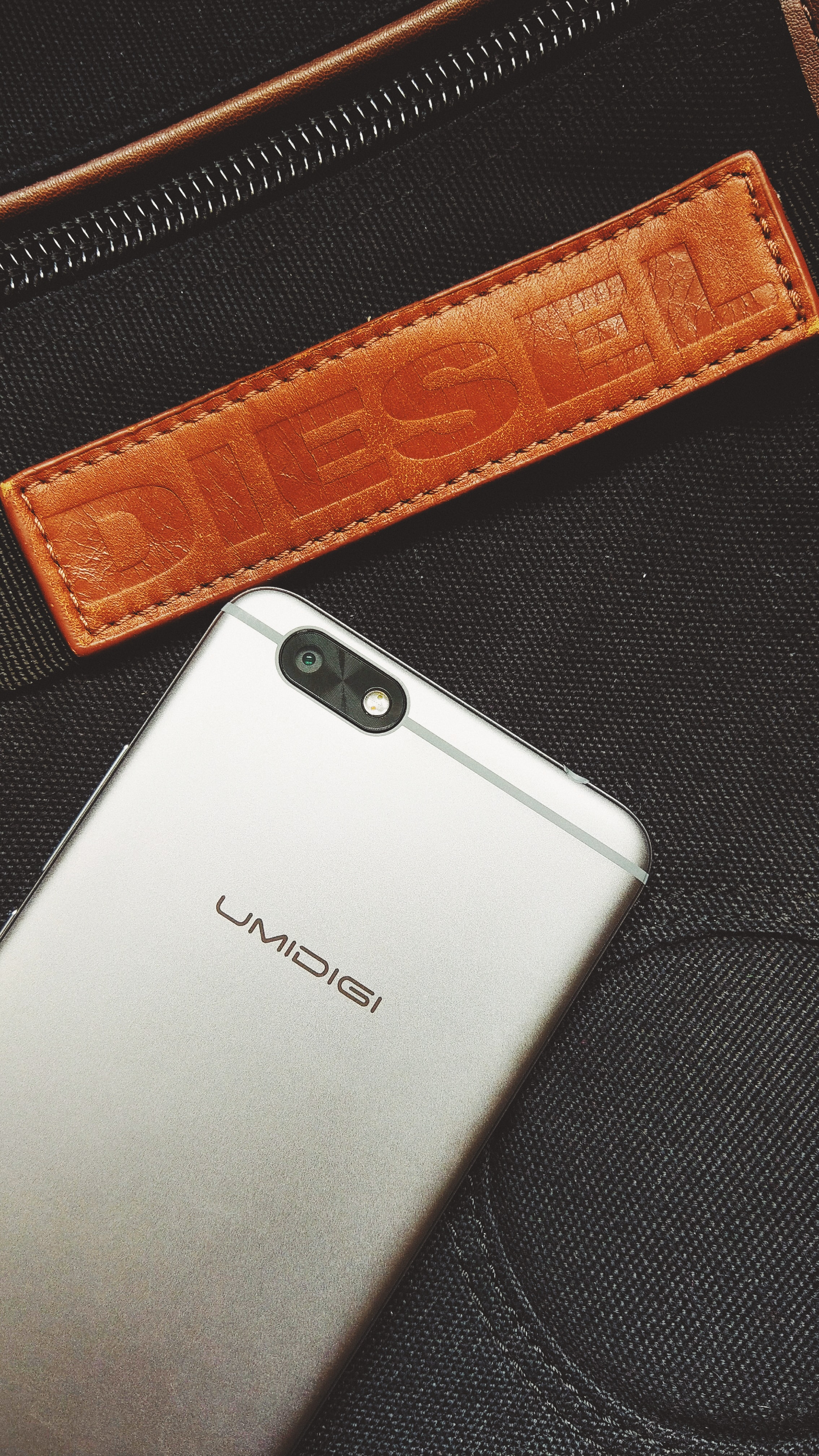 A smartphone on a Diesel branded product.