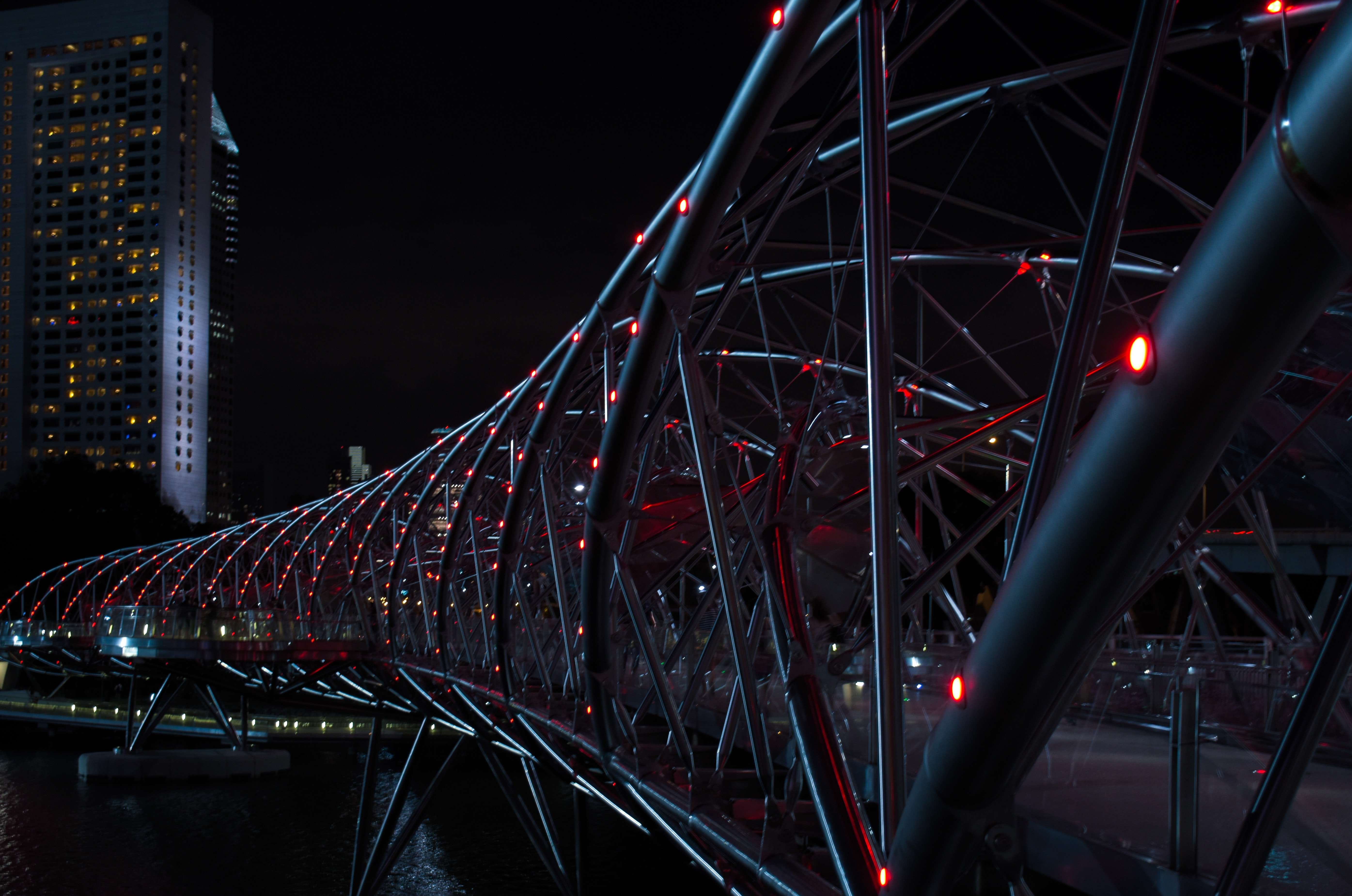 gray Helix Bridge with red lights at nighttime