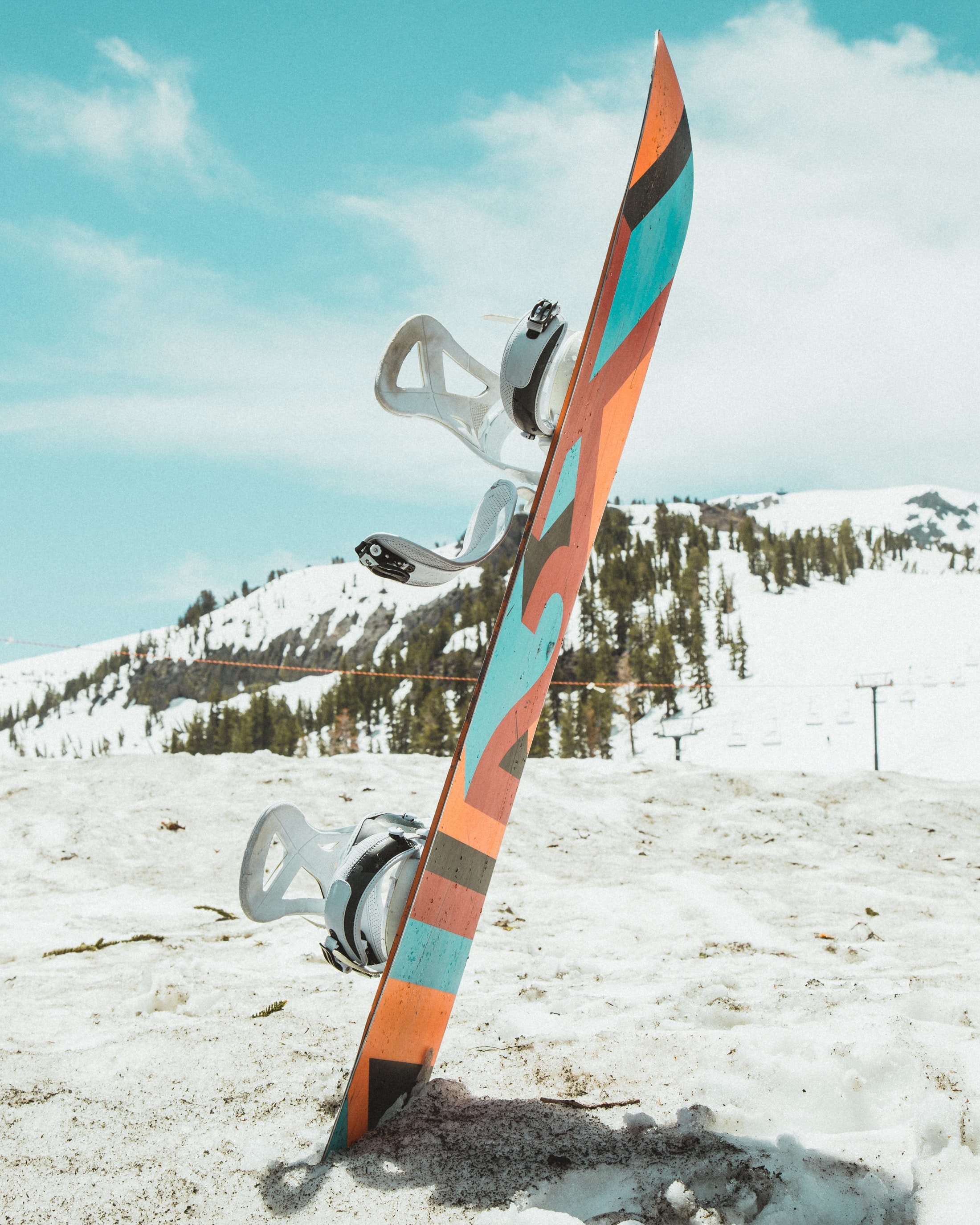 shallow focus photography of multicolored snowboard