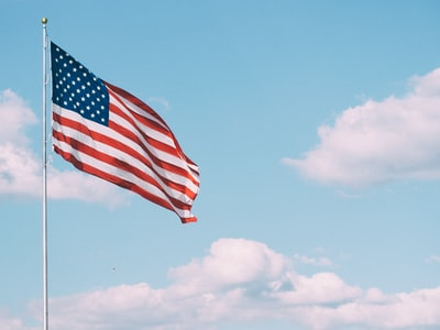 flag of u.s.a. under white clouds during daytime america teams background