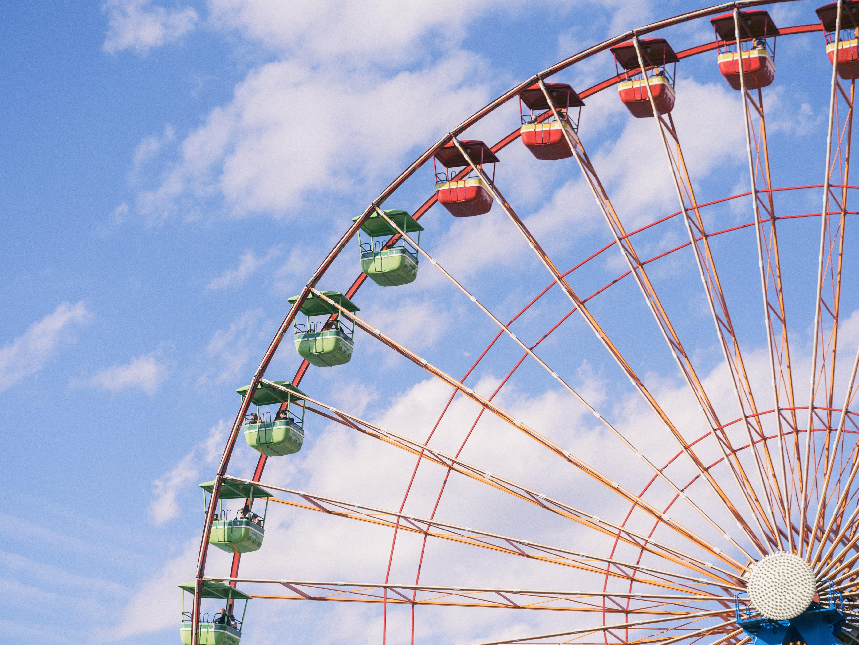 Ferris wheel under cloudy sky during daytime