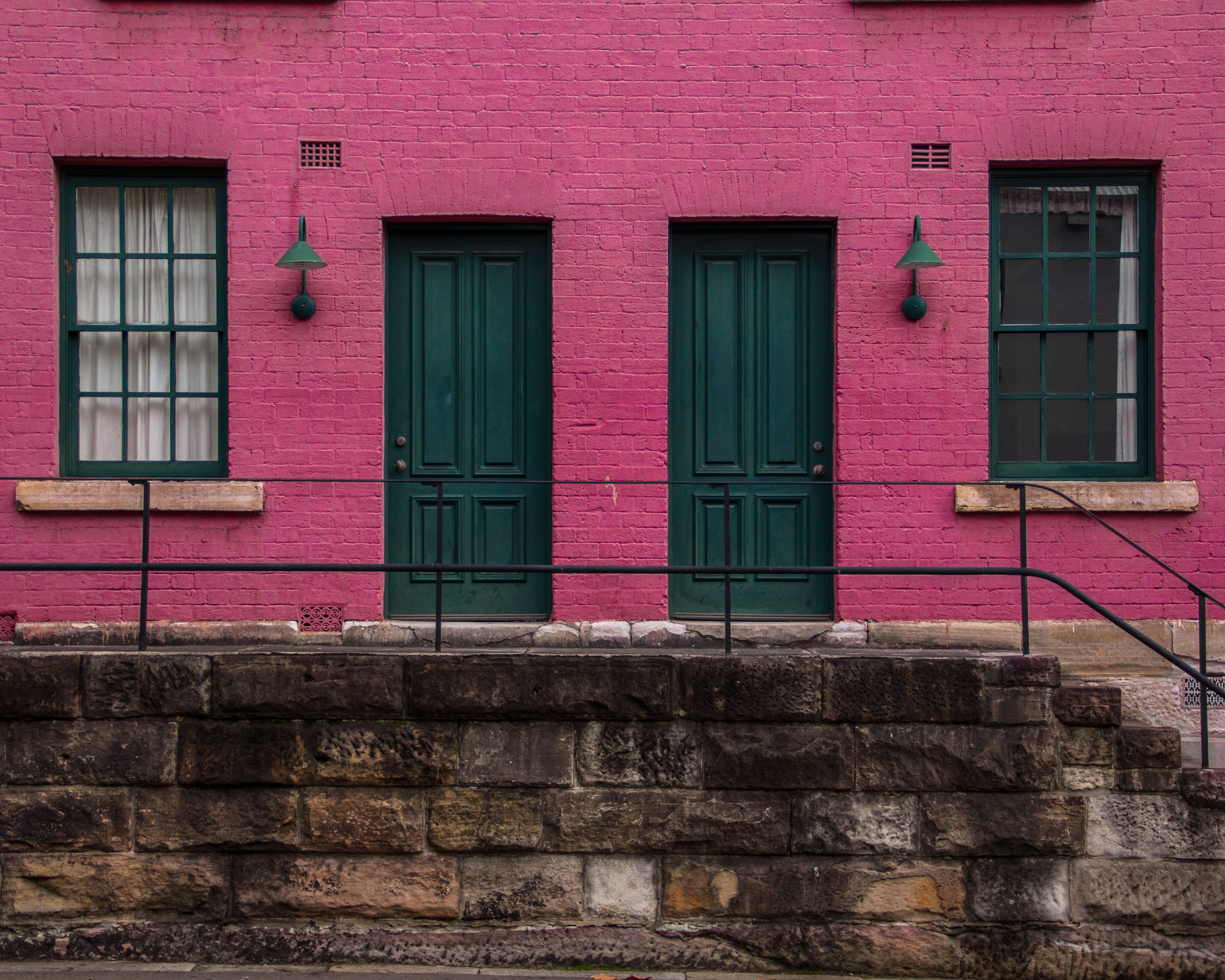 pink house with two doors