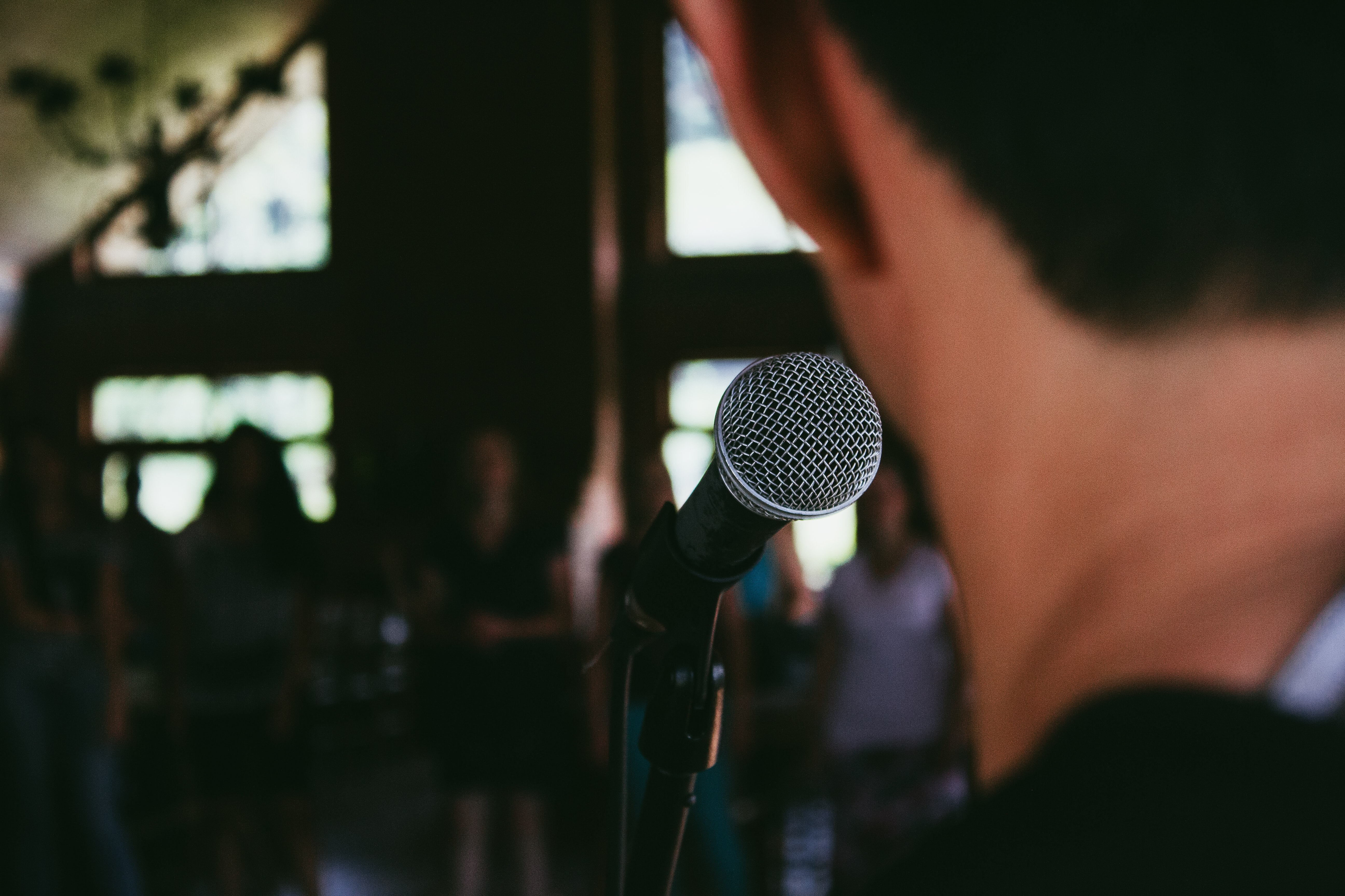 A man standing in front of a microphone in a stand