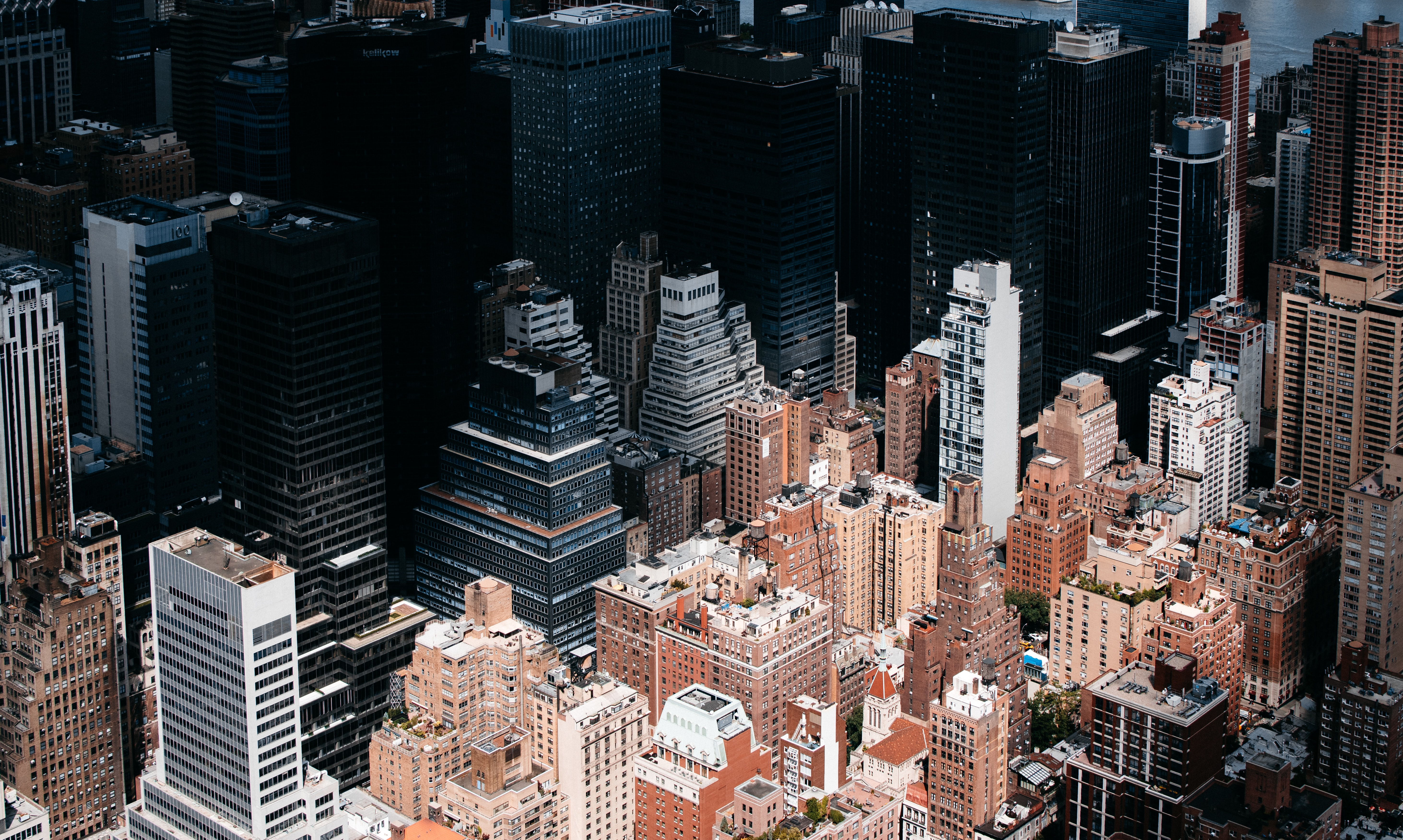 Aerial view of New York City's downtown skyscrapers with dark shadow