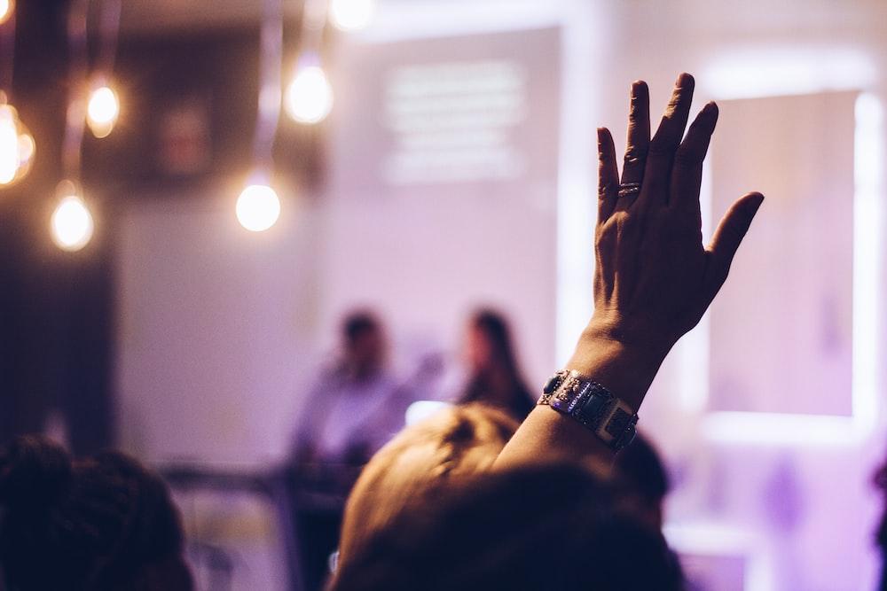 person raising hand