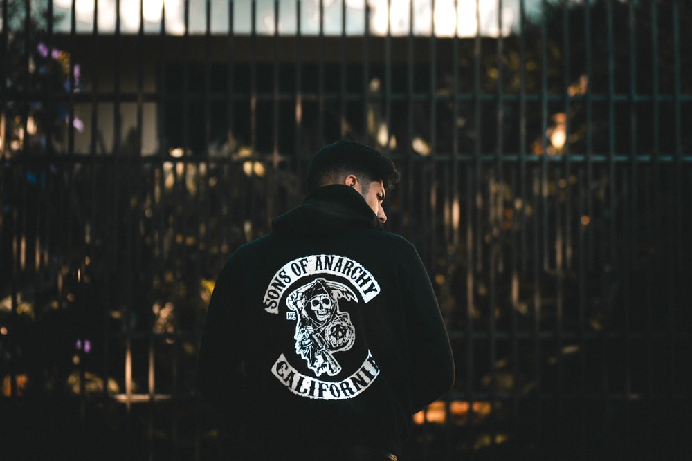 photo of man wearing Sons of Anarchy-printed jacket