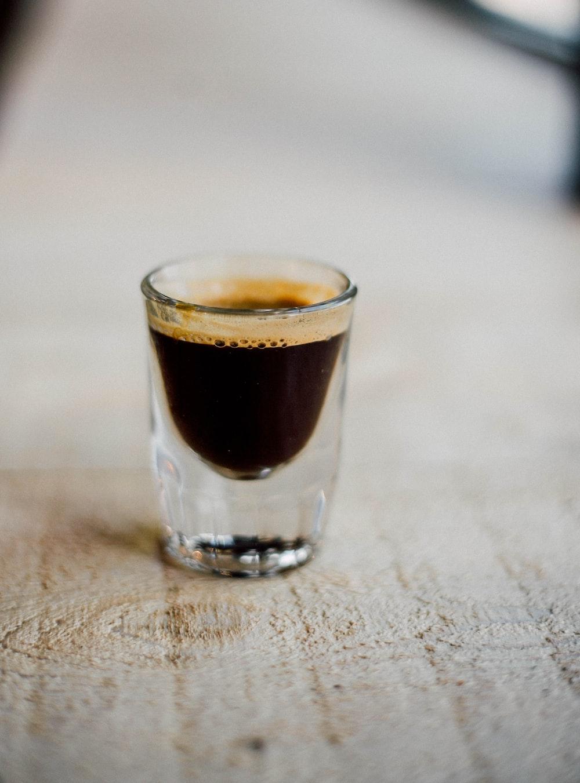 beverage in shot glass