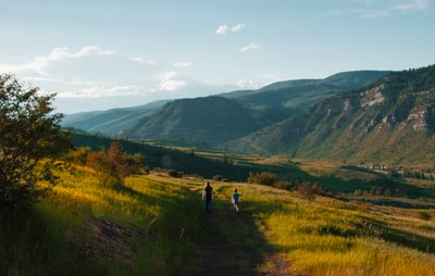 boy and man walking on mountain hill colorado teams background