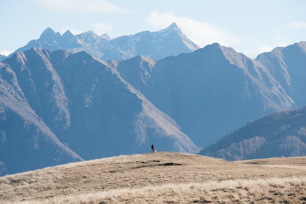 photo of person facing mountain