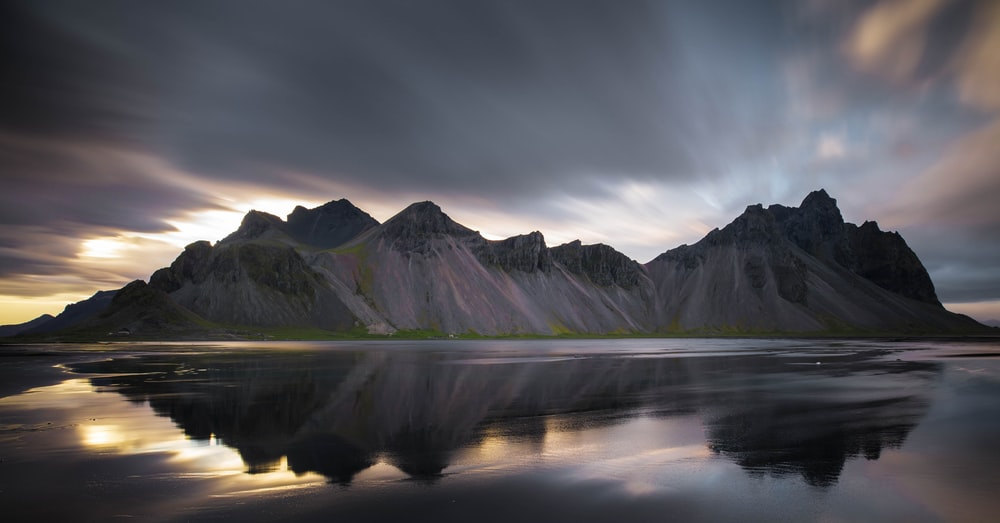landscape photography of mountains near body of water