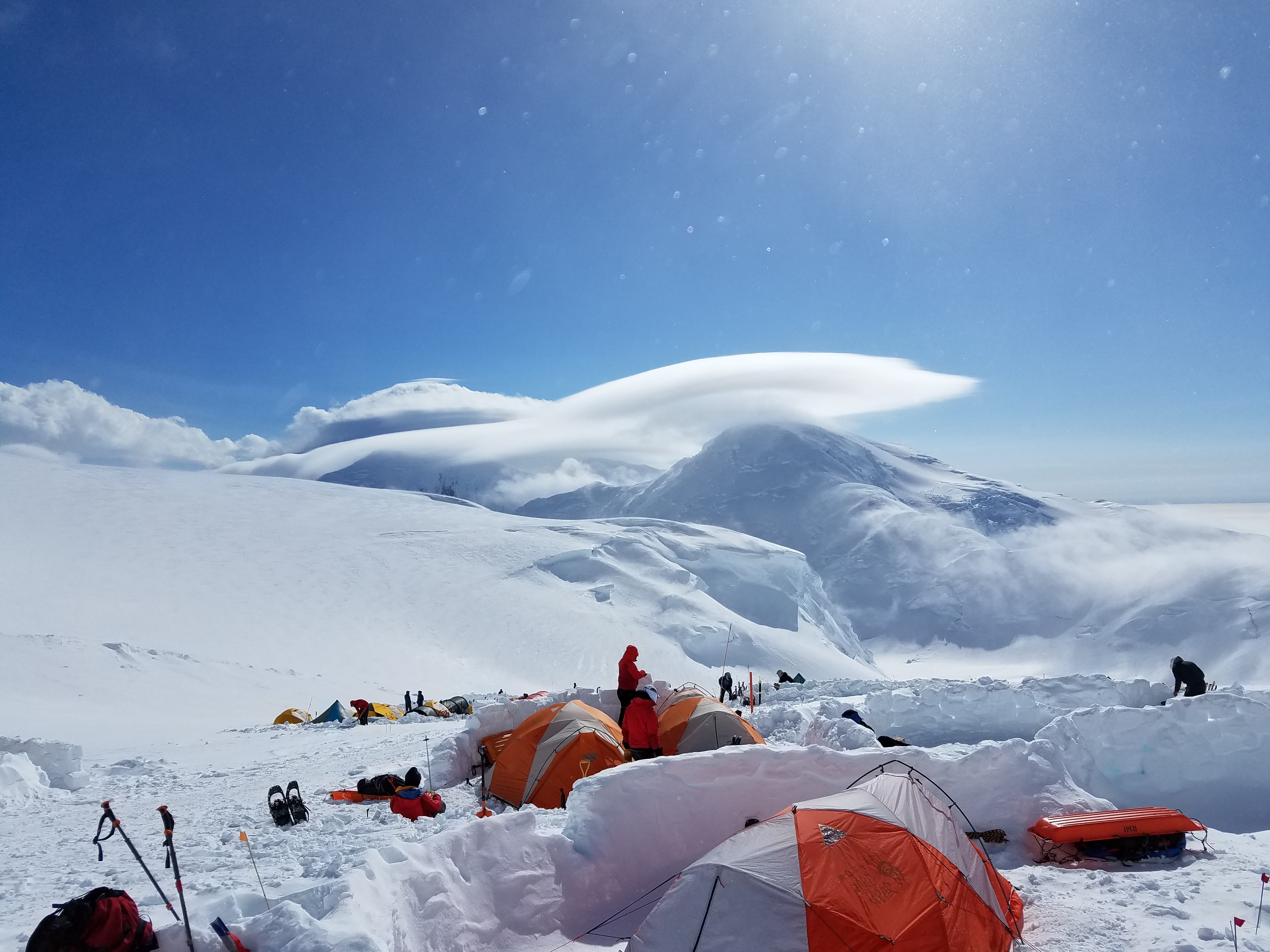group of people camping on snow mountains