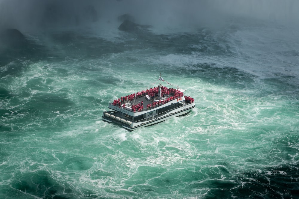 people riding on ship in the middle of the sea