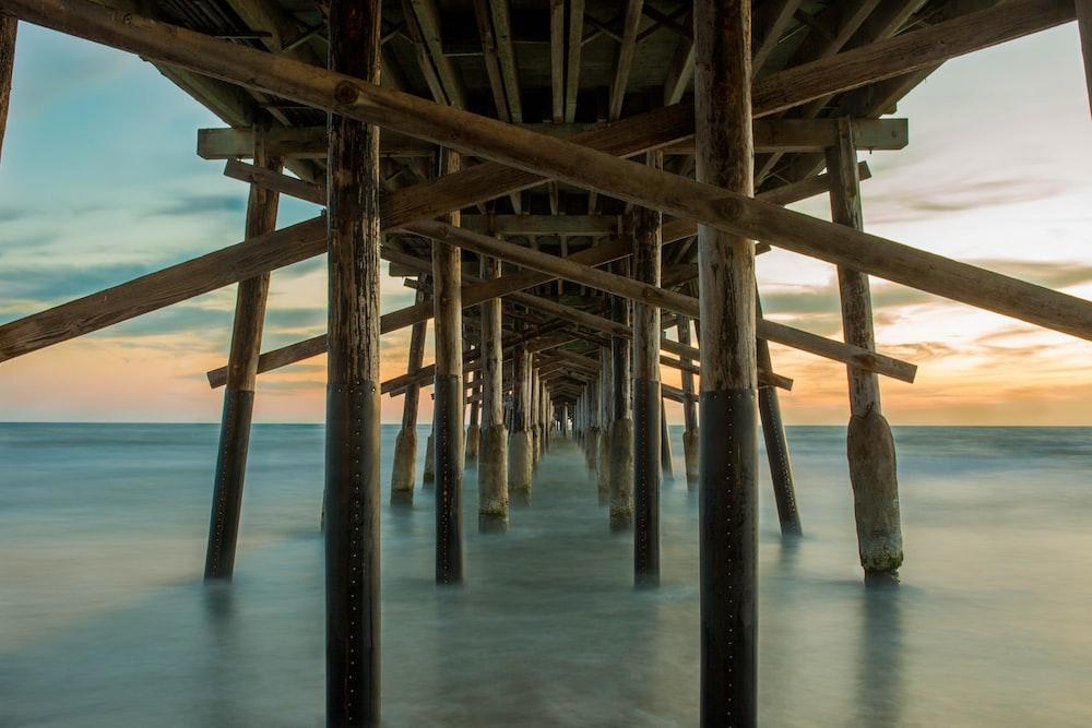 legs of pier in water