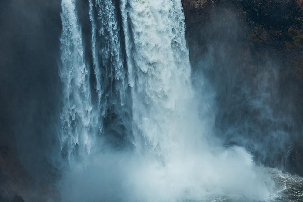 photo of waterfalls rushing into the sea