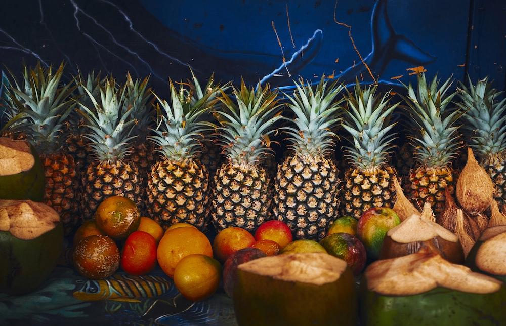 green pineapple fruits lot