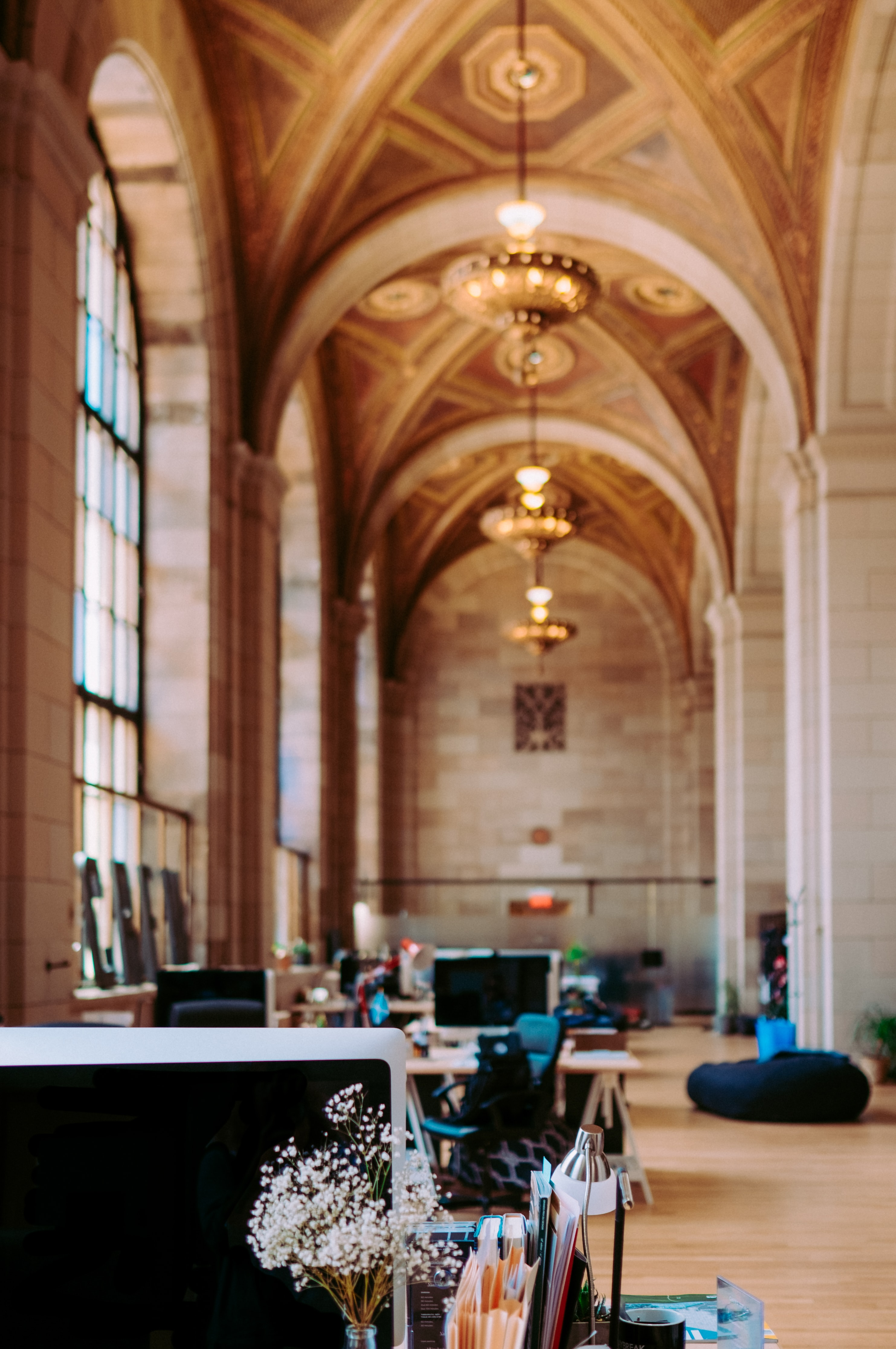 An open office space in a cathedral-style interior