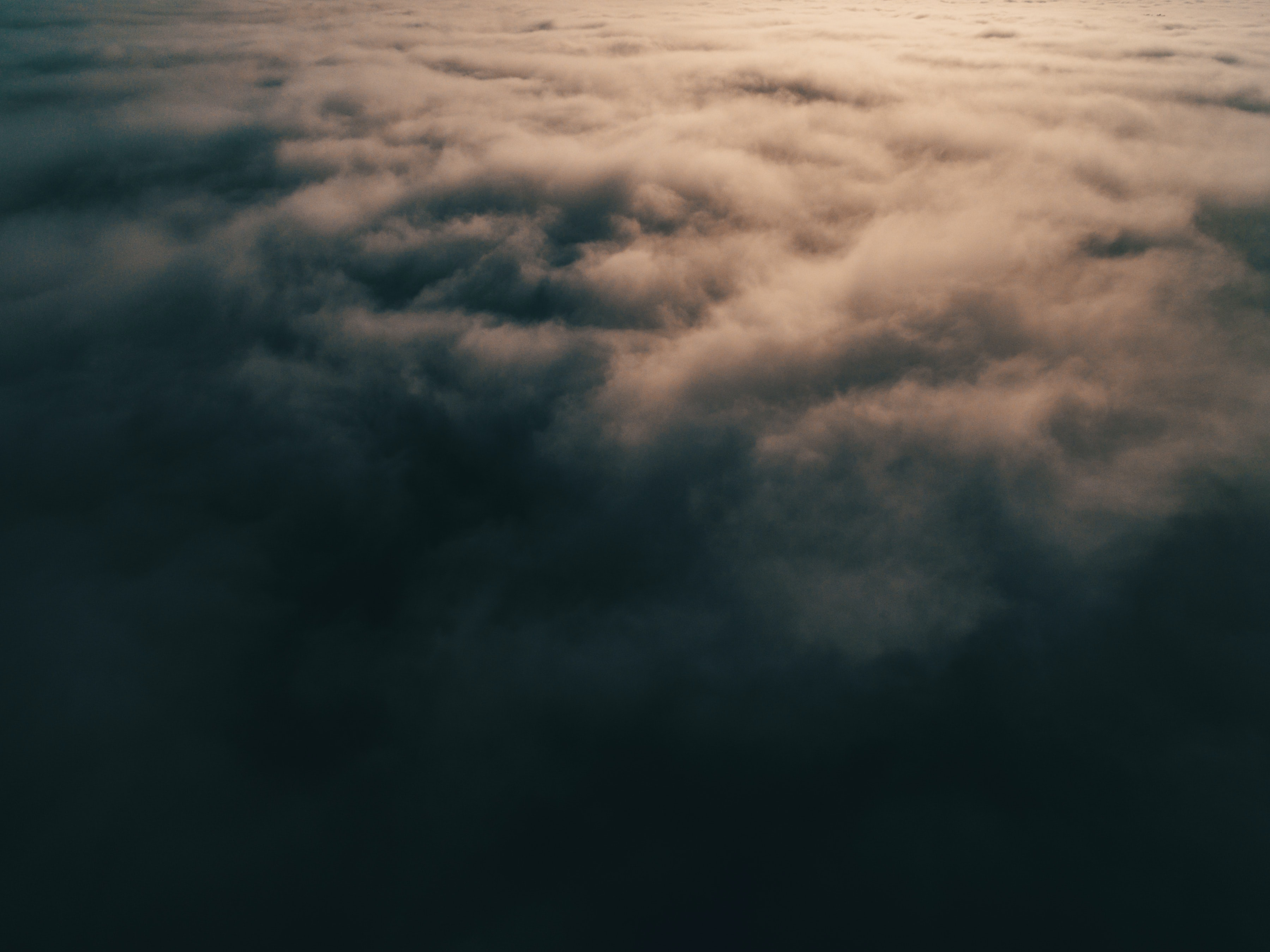 Top of grey clouds with sunlight streaming on them