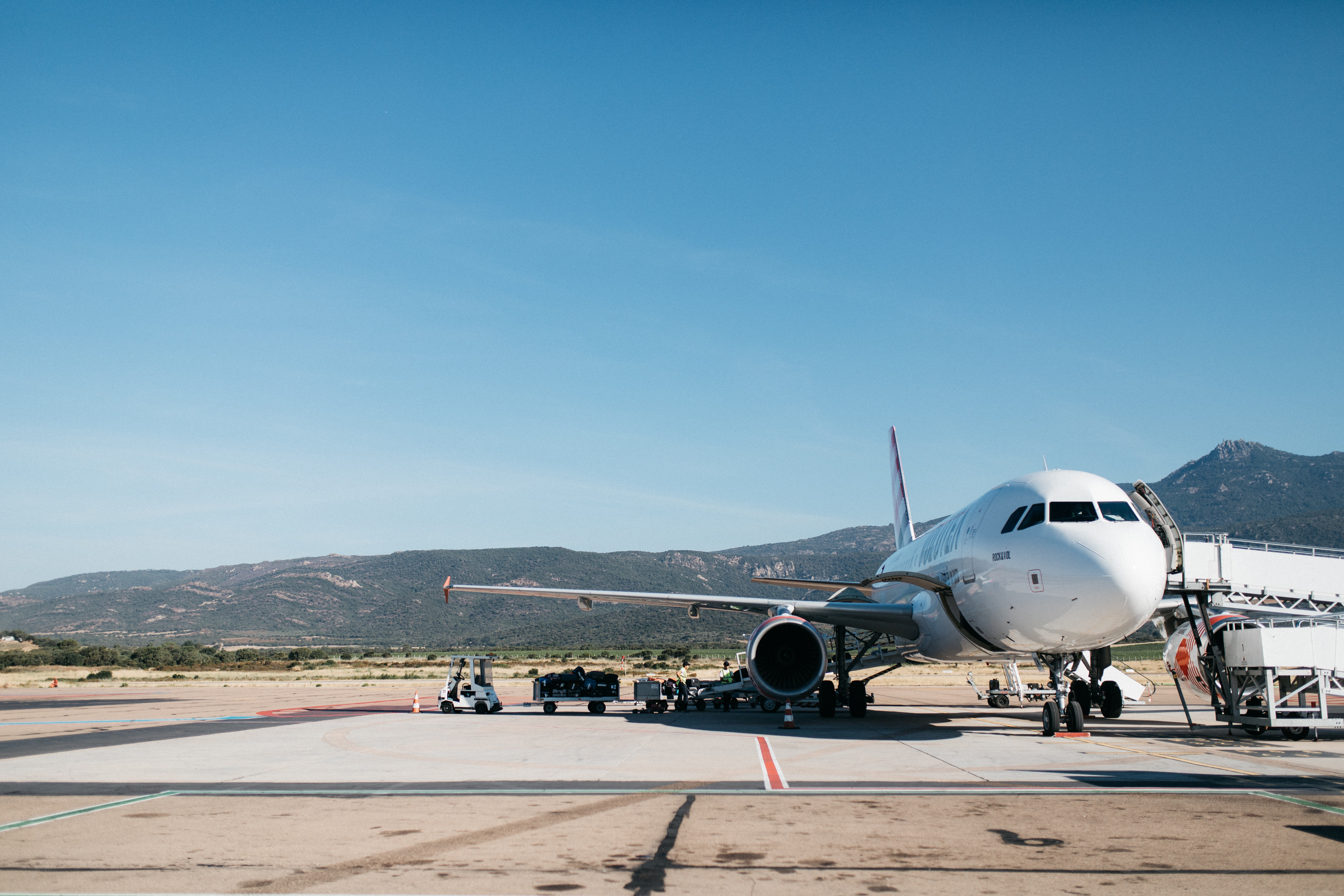 A plane on the airfield on a sunny day in Figari Sud-Corse Airport