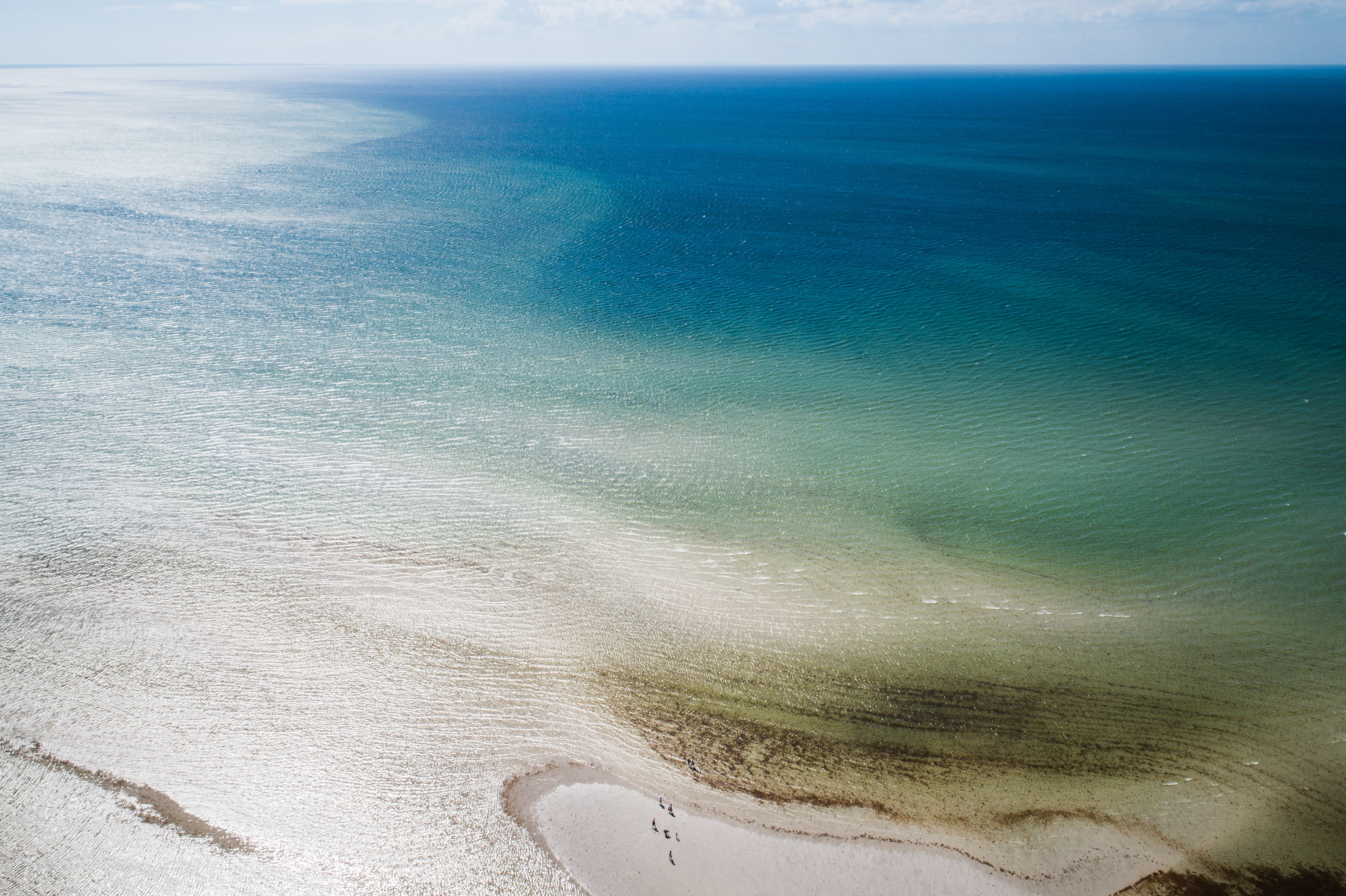 Drone aerial view of the shallow waters near a sand beach at Orleans, Orleans, Massachusetts, United States