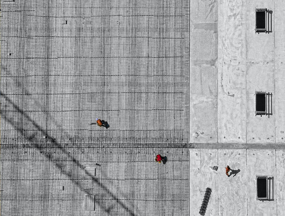 aerial photo of three person walking on floor at daytime
