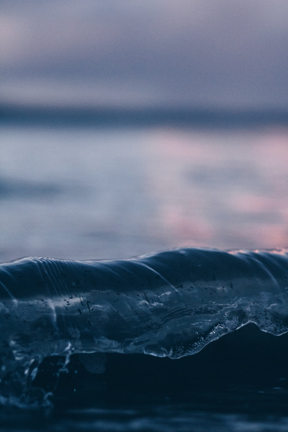 shallow focus photography of water wave