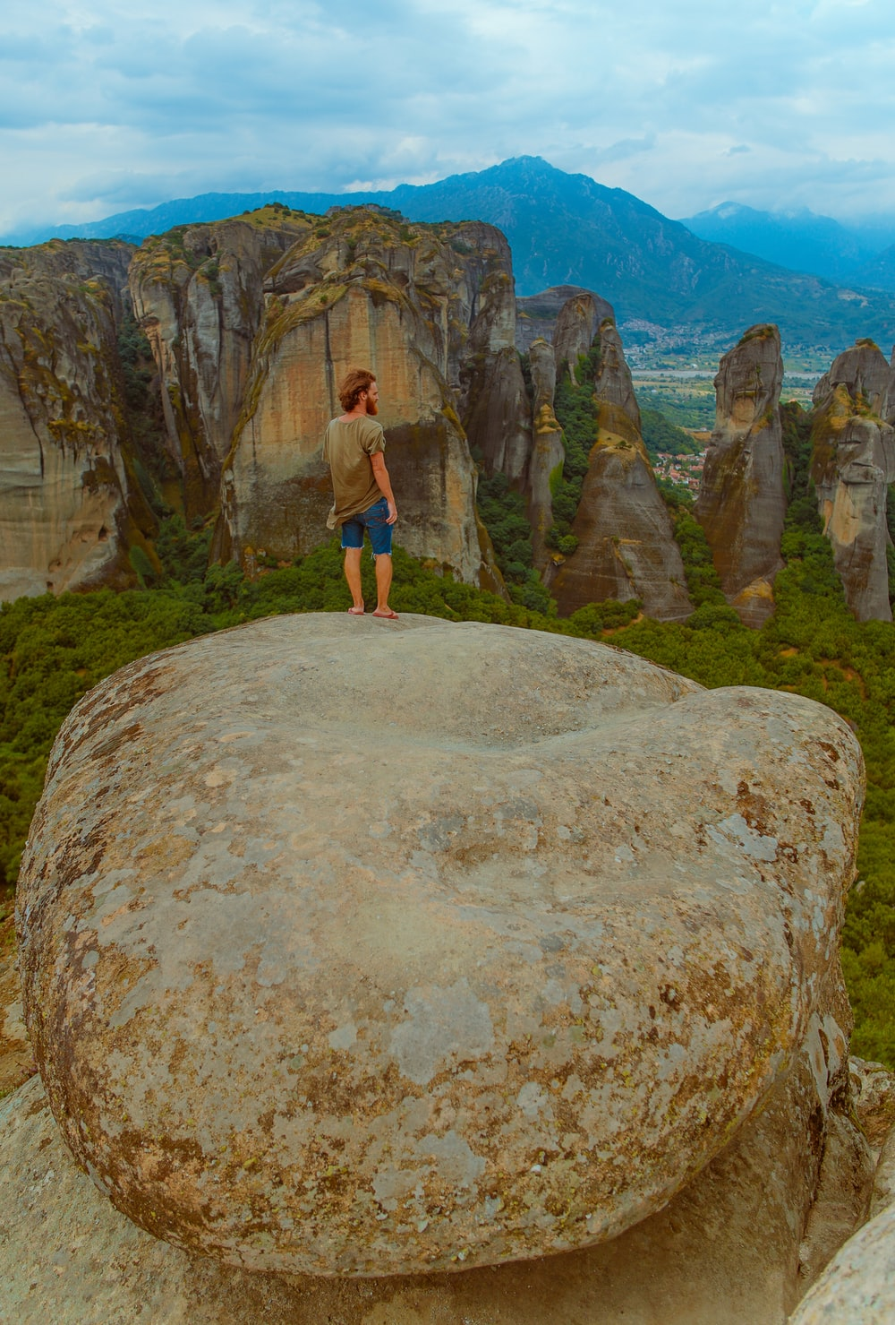 person standing on rock during daytime