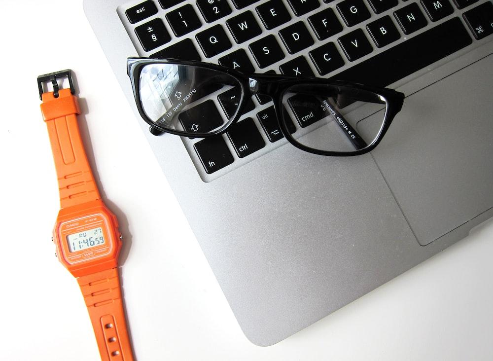 eyeglasses with black frame on MacBook Air