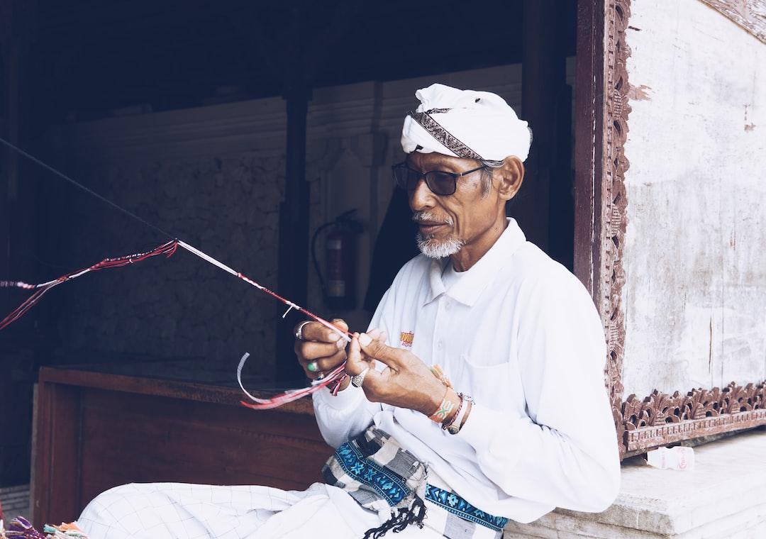 Man weaving at temple