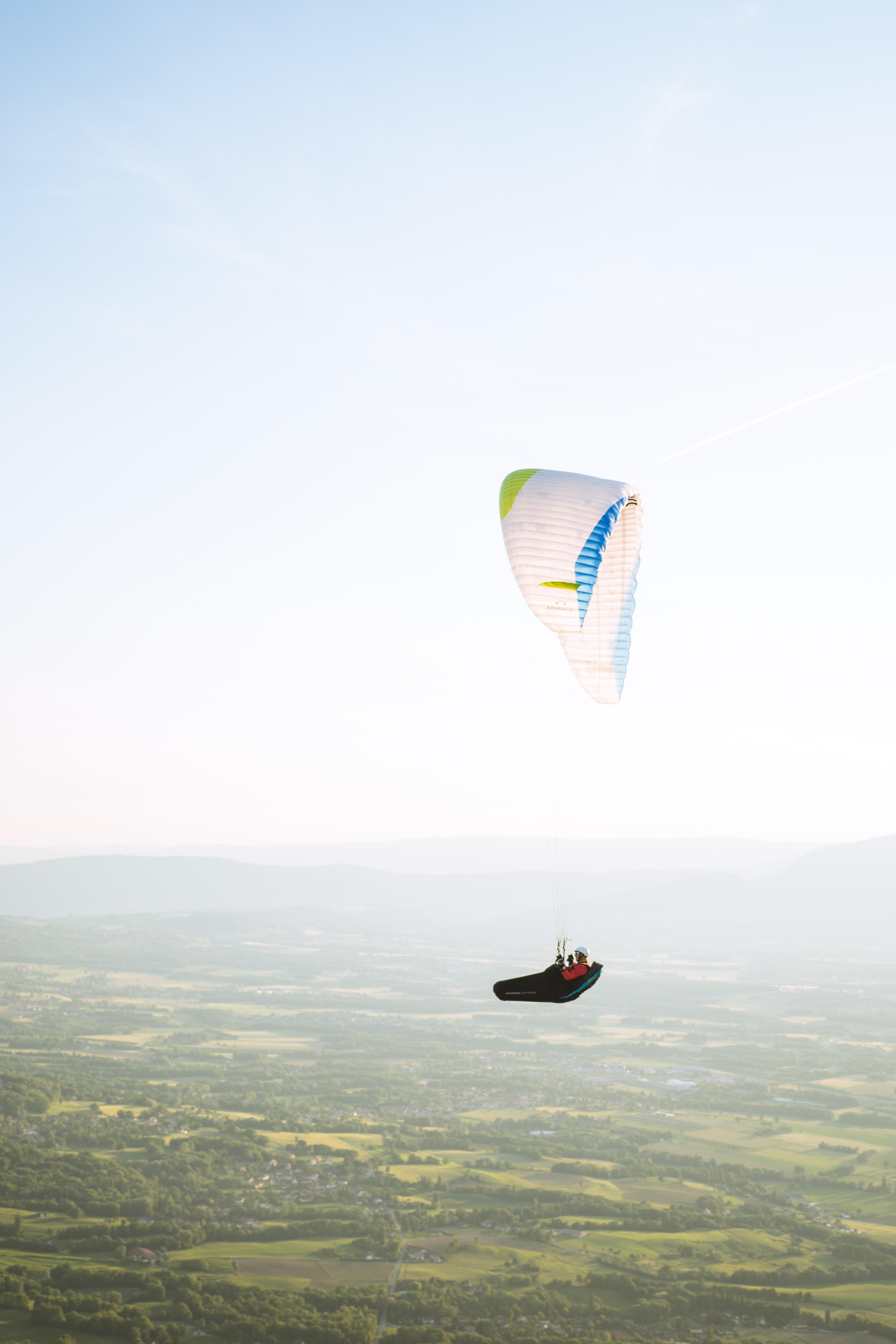 aerial photography of a man parachuting