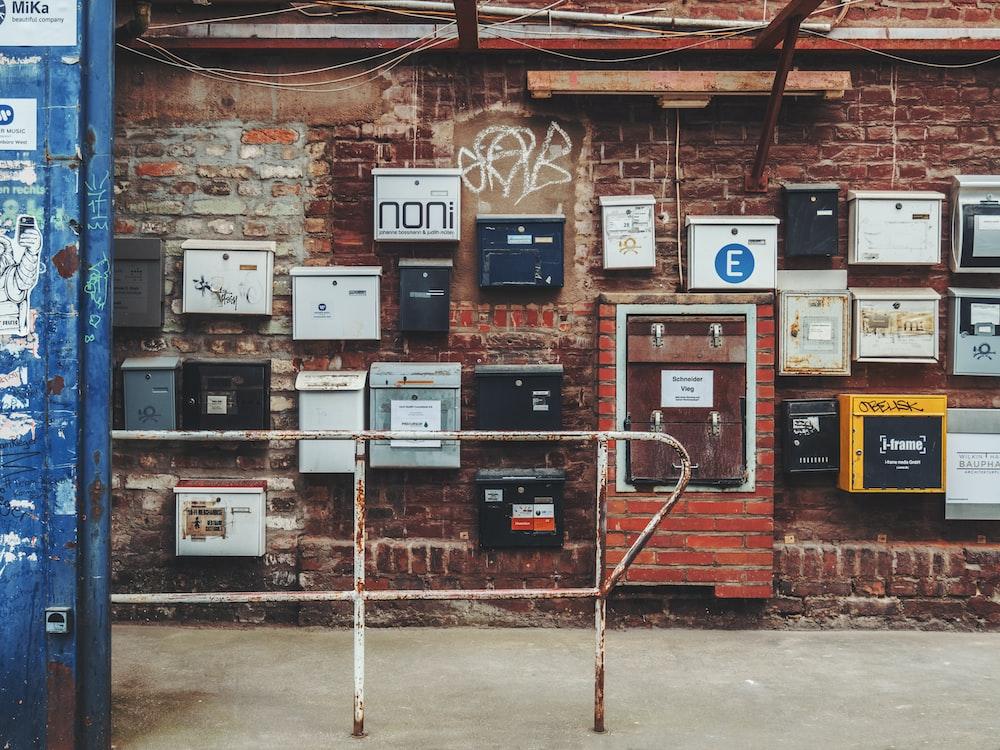 metal boxes on brown brick wall