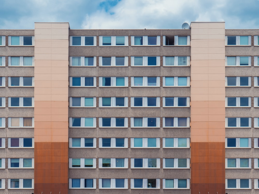 photo of gray and brown high-rise building