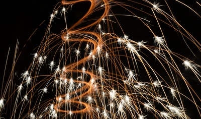 closeup photo of fireworks long exposure teams background