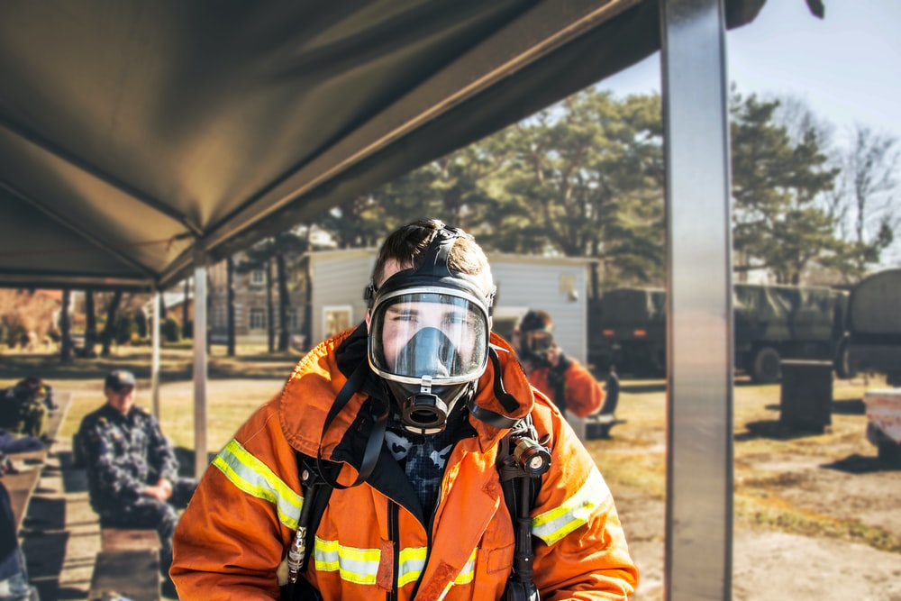 shallow focus photography of firefighter in full suit