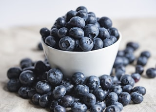 blueberries on white ceramic container