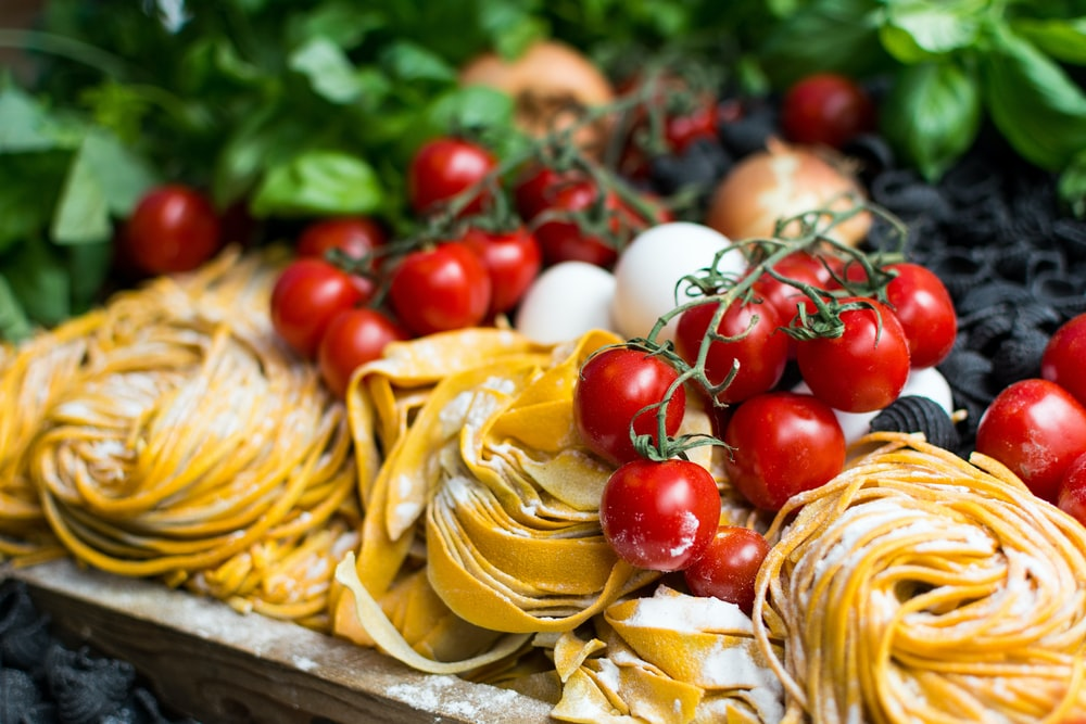 yellow pasta and cherry tomatoes