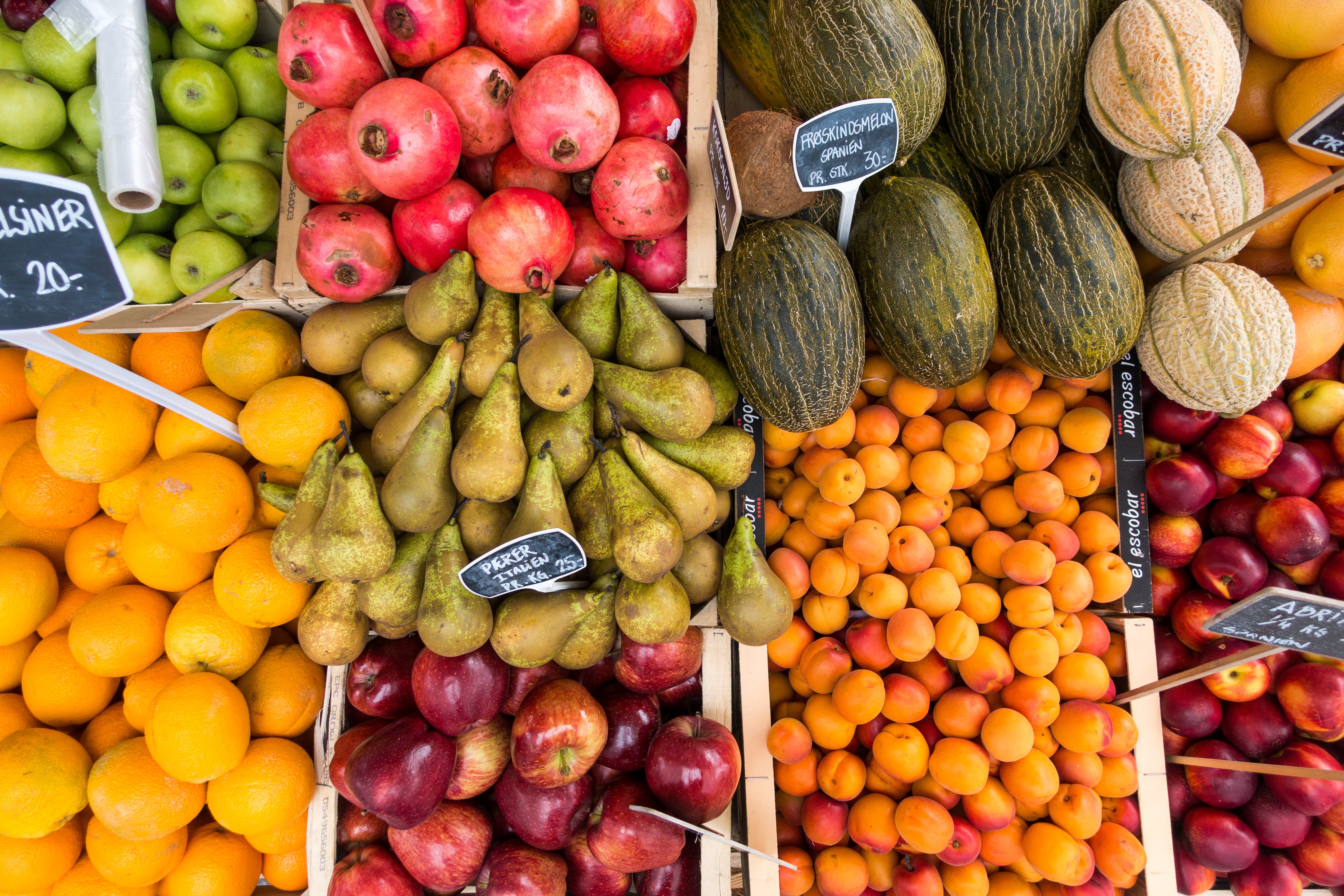 Boxes of fresh fruit and produce at a farmer's market
