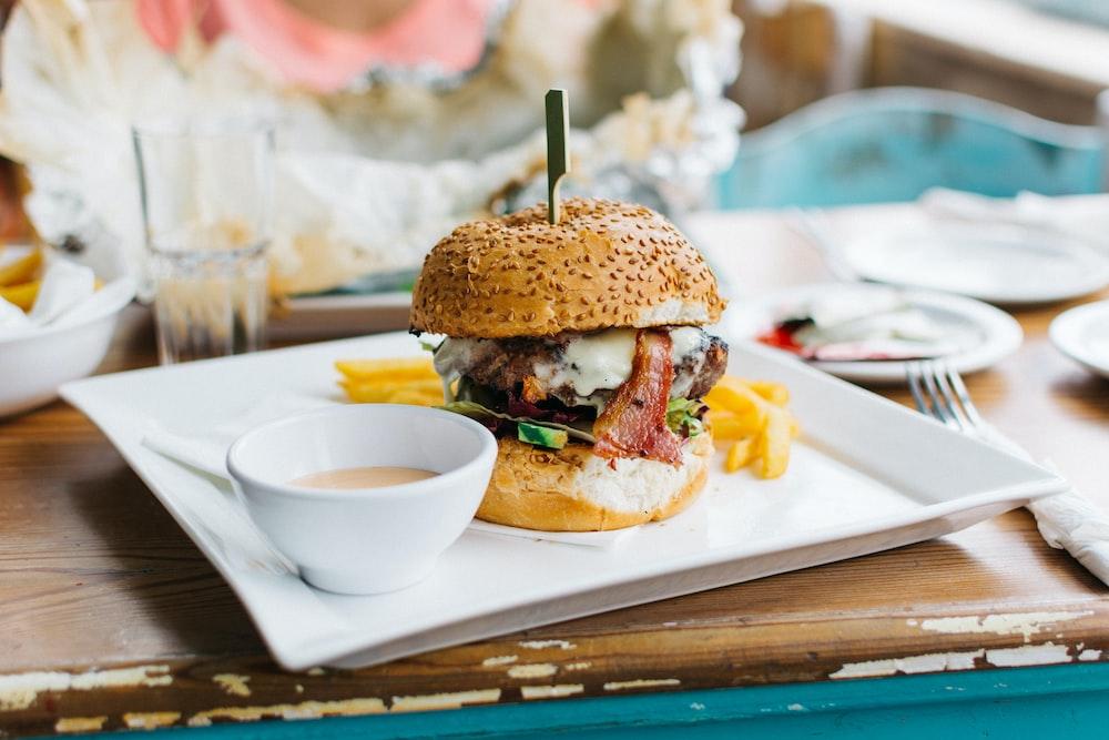 brown burger dish on white ceramic plate
