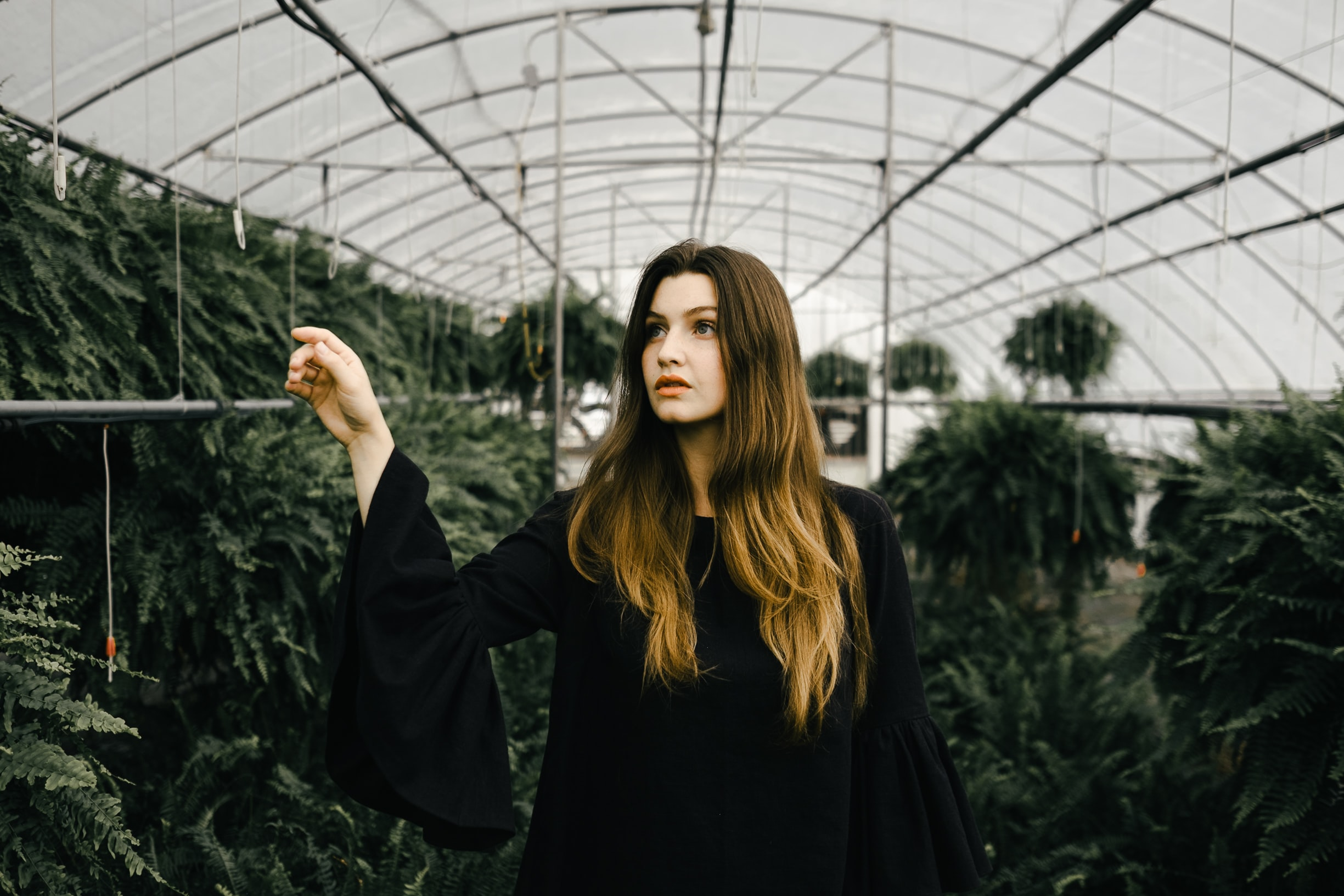 woman walking inside greenhouse