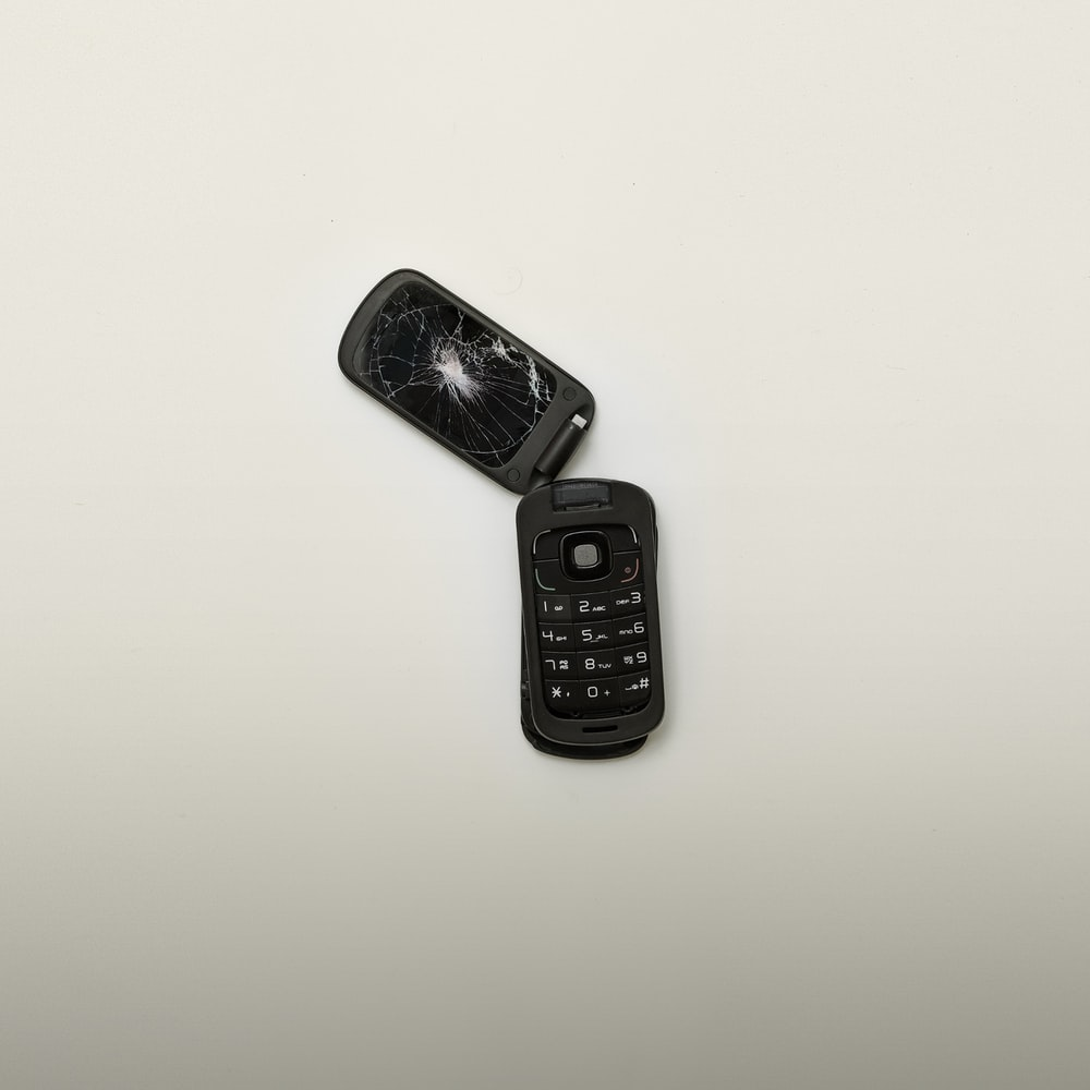 broken black flip phone