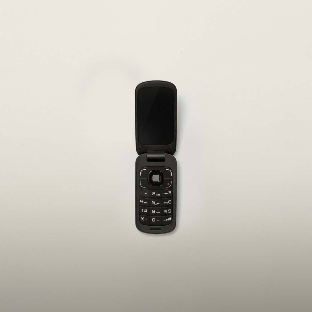 turned-off black flip-phone