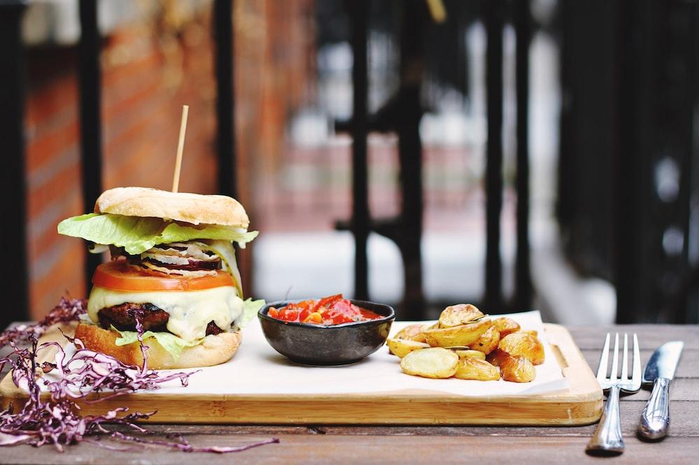 ham burger beside bowl on tray