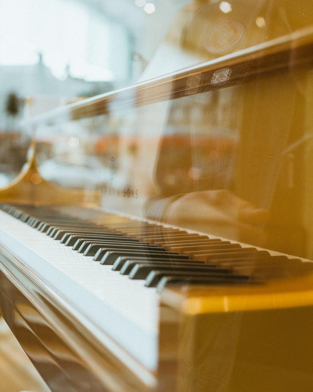 low-angle of brown piano