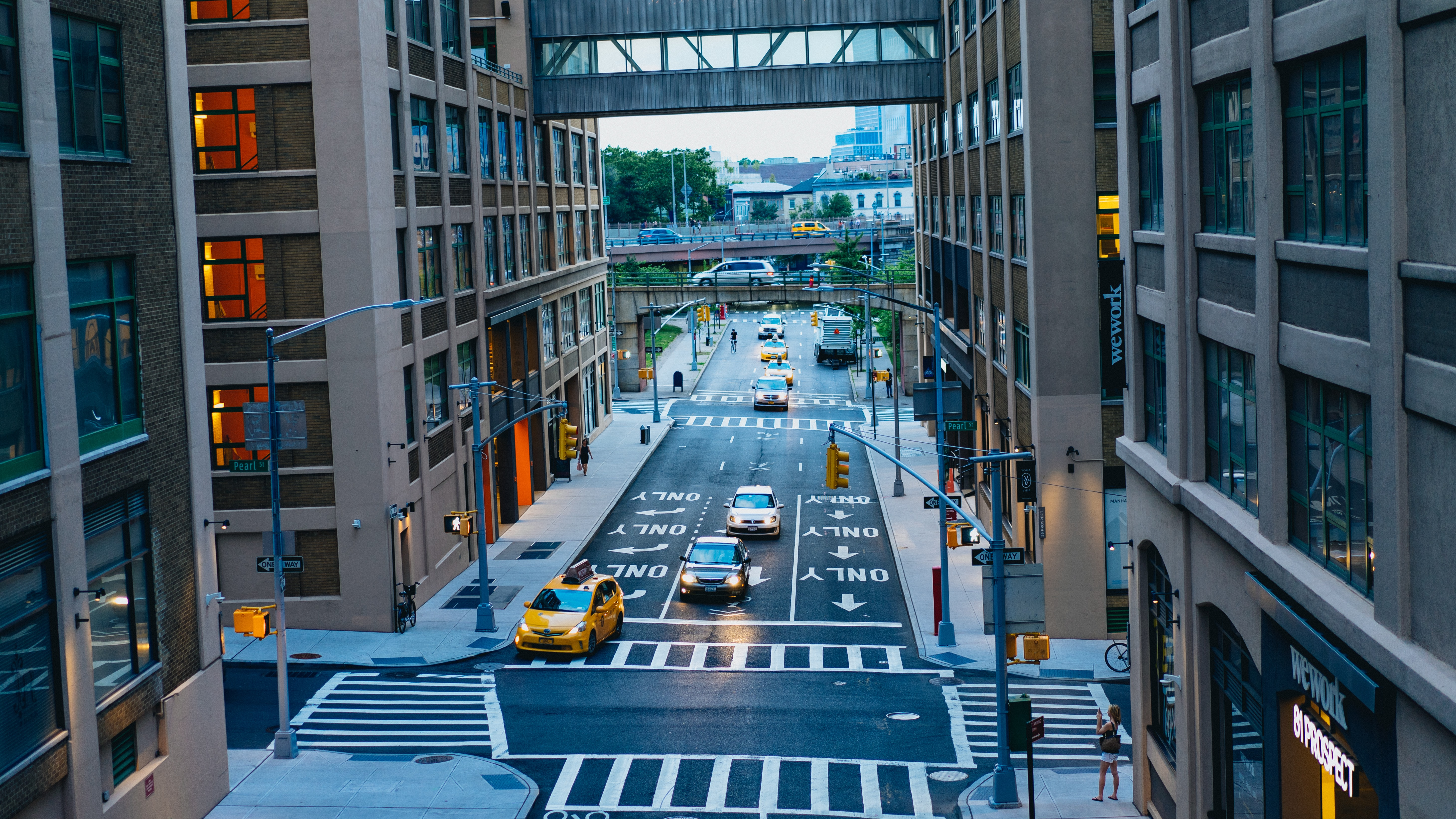 road between brown and black high-rise buildings