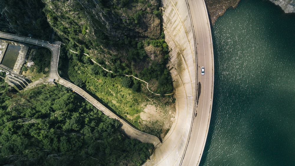 aerial photography of white vehicle on concrete road at daytime
