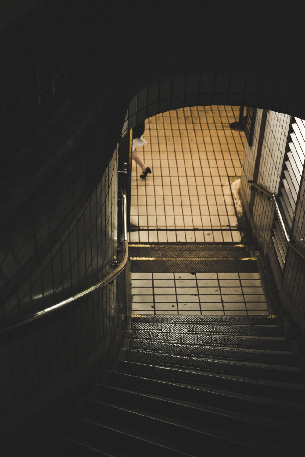 person walking near stairs