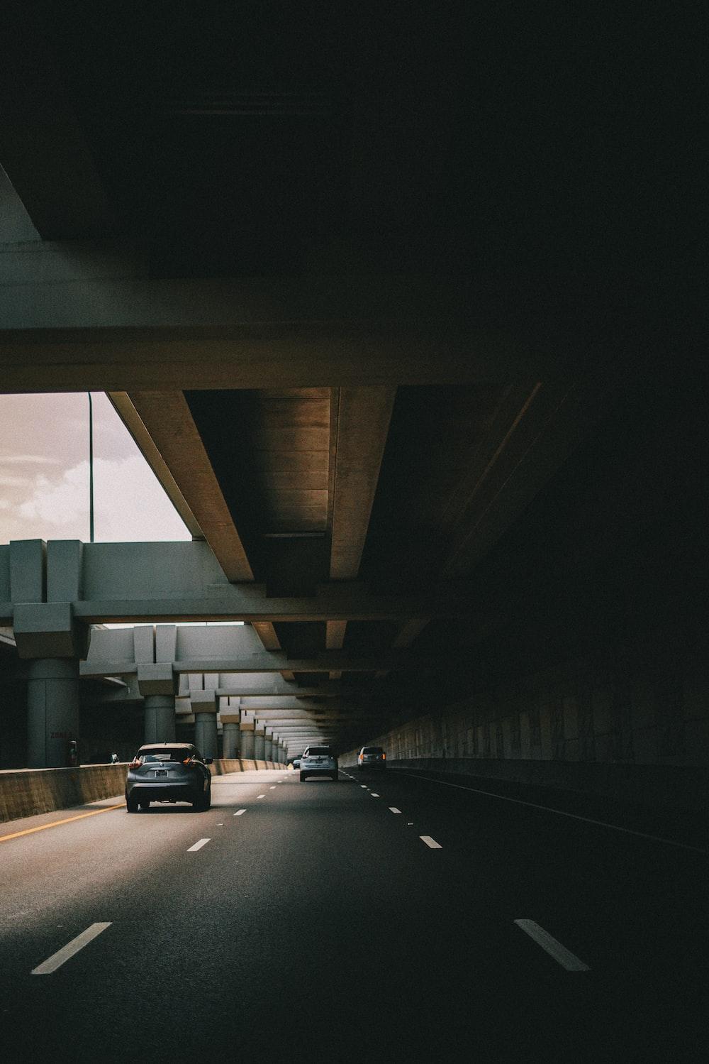 running vehicles on road under bridge