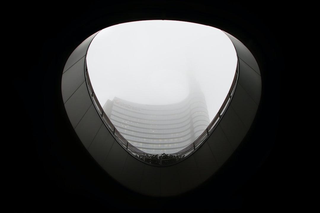 monochrome building roof hole