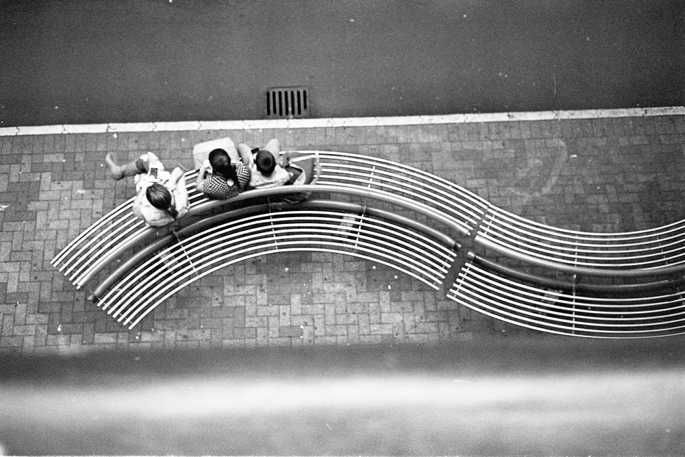 aerial photography of persons sitting on bench