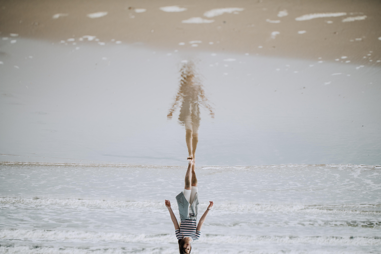 woman walking on beach shore